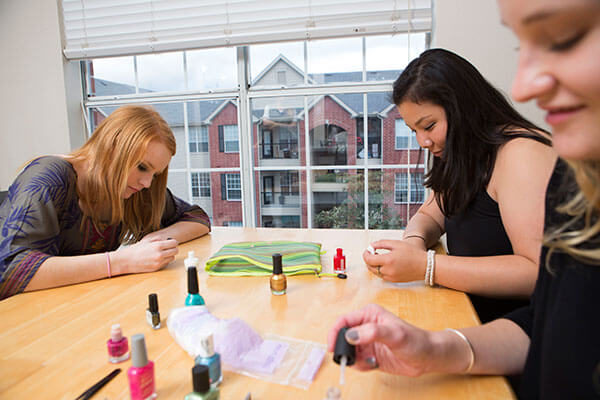 women painting their nails