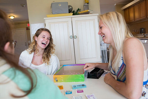 women playing a board game