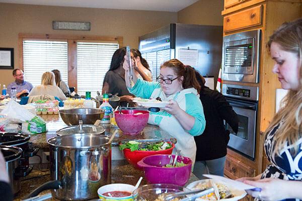 women getting food