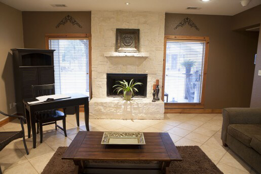 room with tables and fireplace